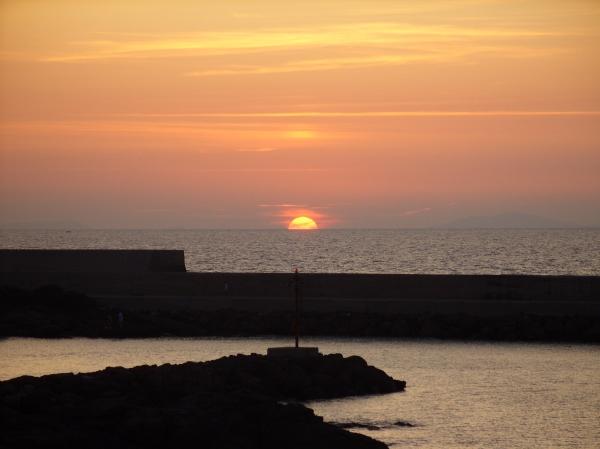 The sun setting over the sea off the coast of Sicily