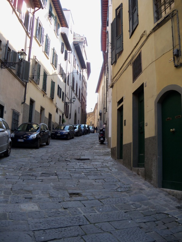 A narrow, hilly street south of the river in Florence
