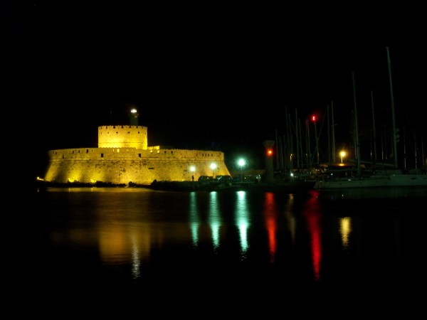 The fort at the mouth of Rhodes harbour as seen late at night