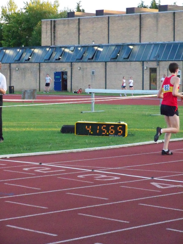 The fastest runner at the mile meeting passes the finish line close to the 4-minute mark