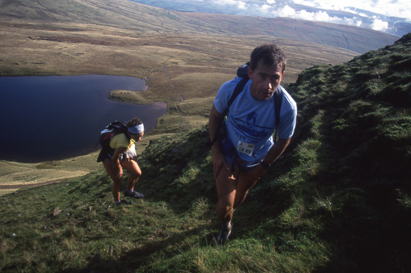 Martin Stone and Helene Diamantides ascending through the Black Mountains in South Wales on the fifth day of the Dragon's Back Race.