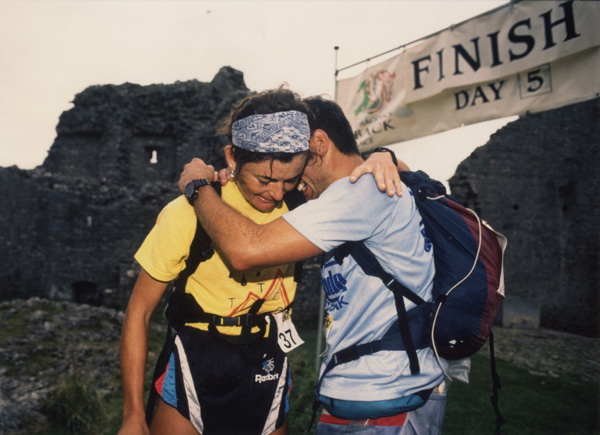 An emotional moment for the winners; Martin Stone and Helene Diamantides at the Carreg Cennen Castle finish line.