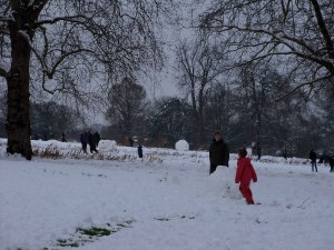 Snow men and sledges in Springfield Park